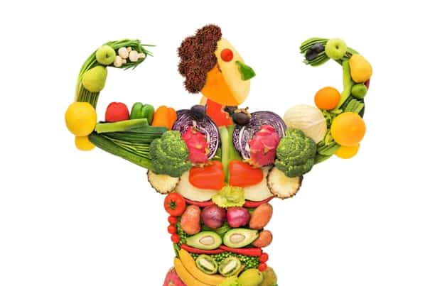 image of a man flexing made out of fruits and vegetables
